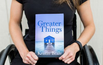 Kristin Beale holding her book Greater Things